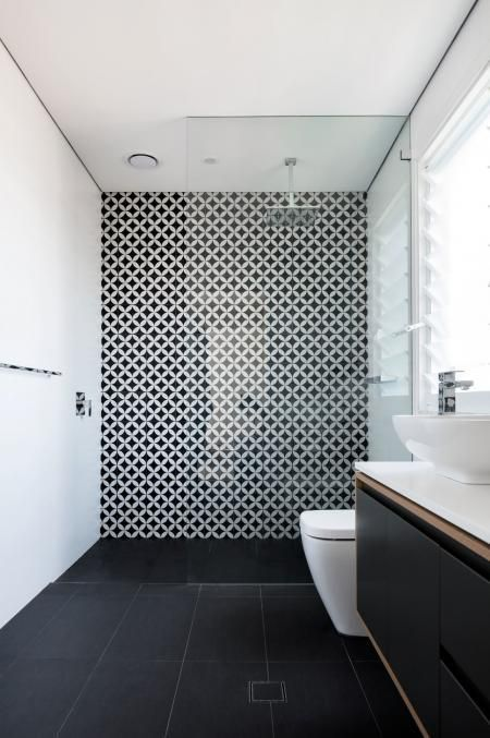 a monochromatic space with mosaic tiles in the shower zone for a stylish accent