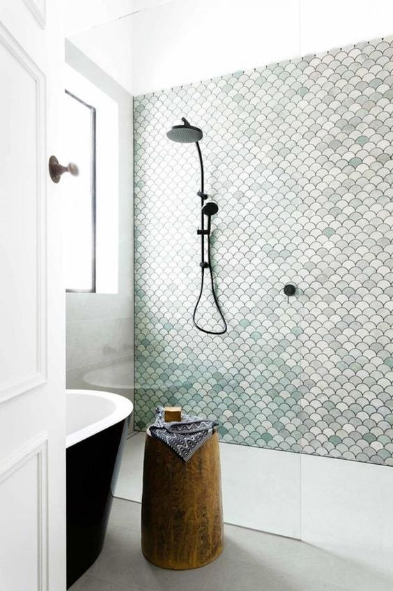 a neutral bathroom with an aqua tile statement wall for a seaside feel