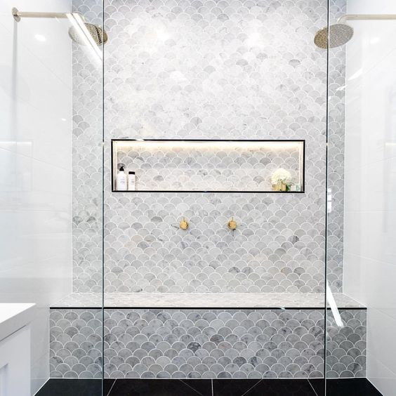 make a statement with grey marble fish scale tiles and additonal lights in the box
