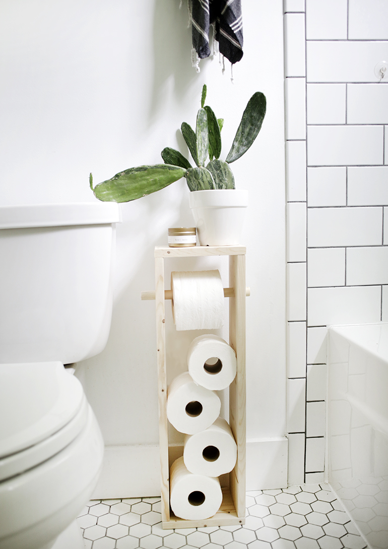 DIY minimalist wood box toilet paper stand (via themerrythought.com)
