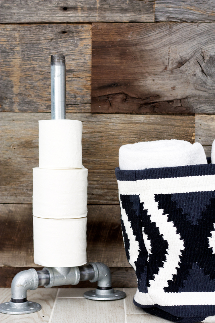 DIY floor standing toilet paper holder (via www.kristimurphy.com)