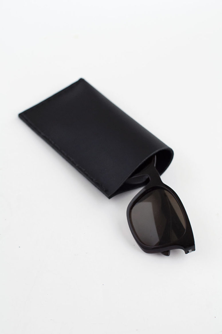 DIY black leather sunglasses pouch (via www.homeyohmy.com)