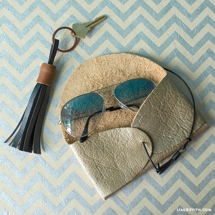 DIY metallic leather sunglasses case with a leather cord (via liagriffith.com)