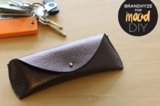 DIY brown leather sunnies case with a button