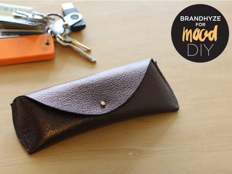 DIY brown leather sunnies case with a button (via www.moodfabrics.com)
