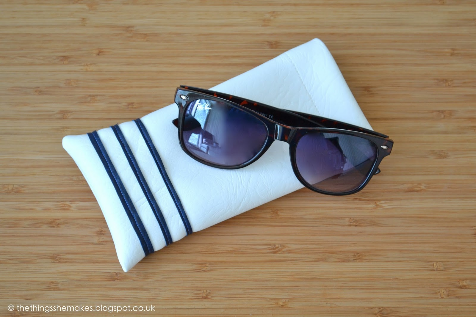 DIY white sunglasses case with blue stripes