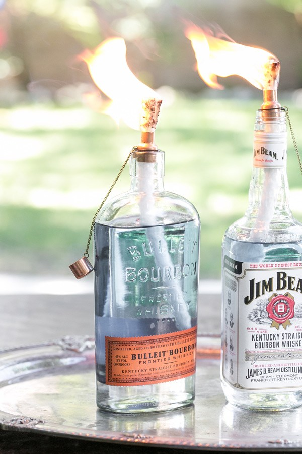 DIY stylish whiskey bottle tiki torches (via sugarandcharm.com)