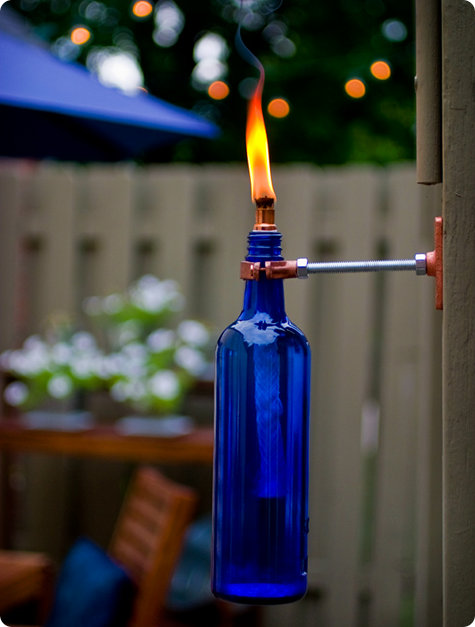 DIY bold blue wine bottle with copper fixtures to attach to the wall (via www.designsponge.com)