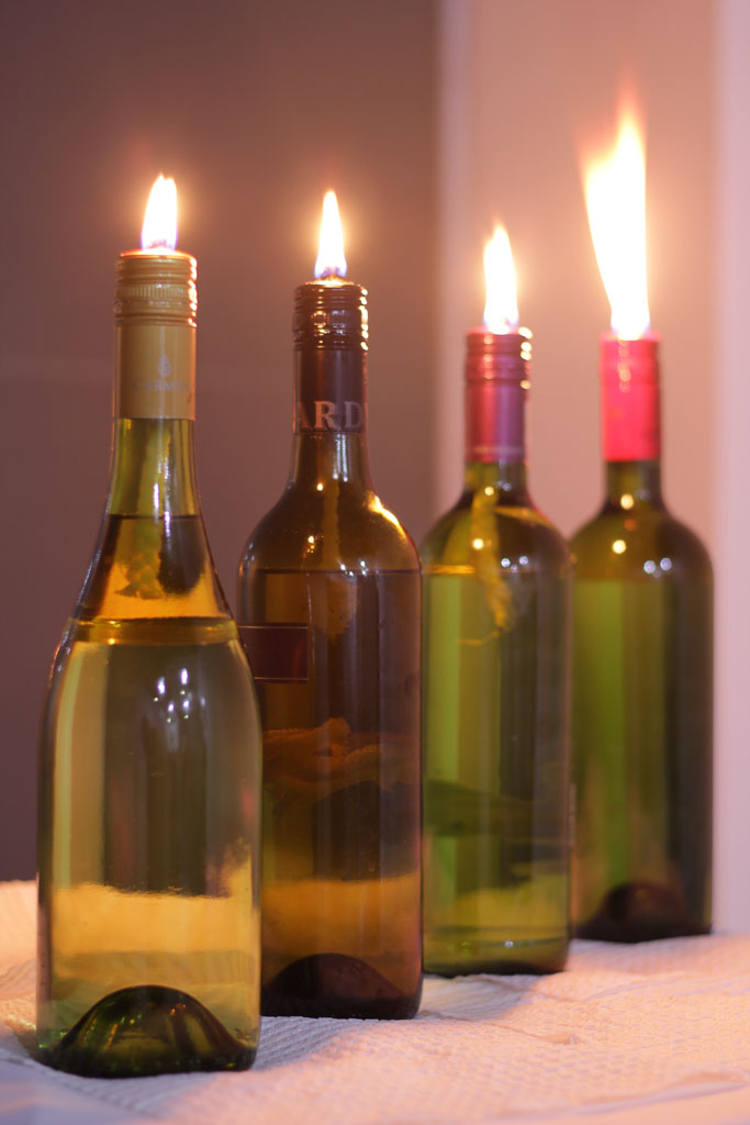 DIY simple wine bottle tiki torches (via www.gennamarie.com)