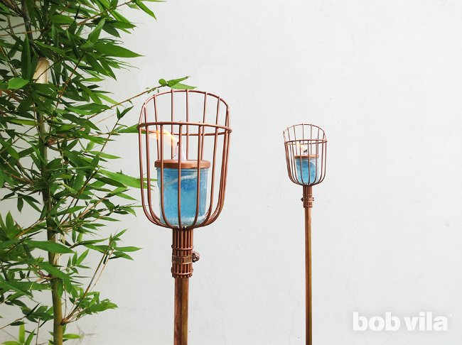 chic DIY tiki torches of copper and jars (via www.bobvila.com)