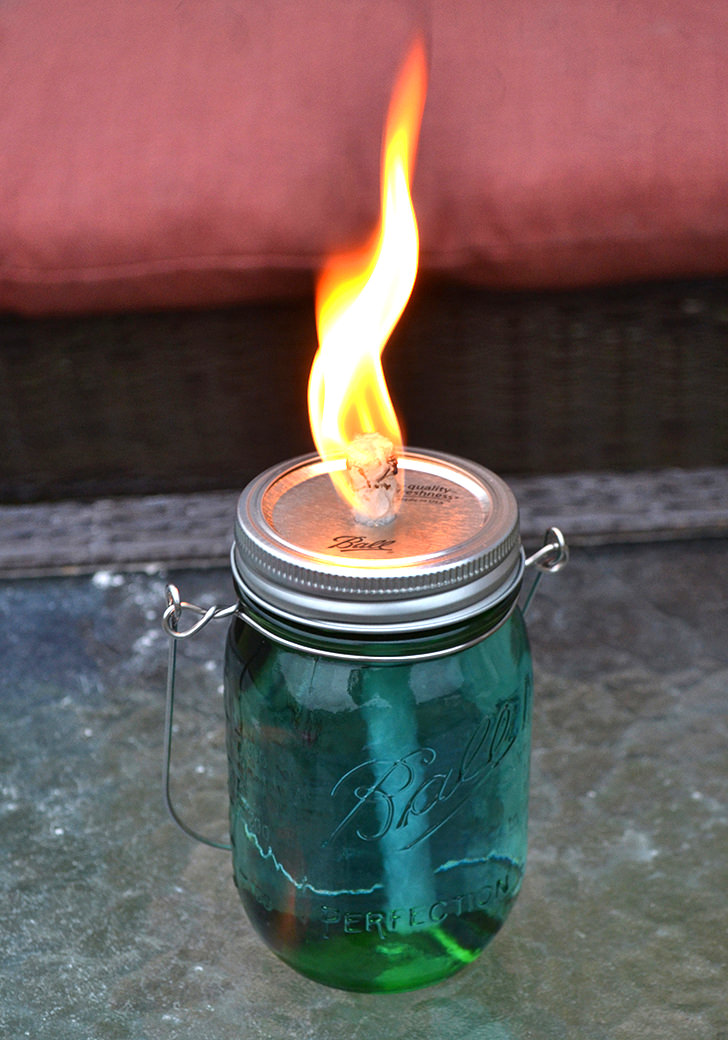 DIY tiki torch of a mason jar (via www.dreamalittlebigger.com)