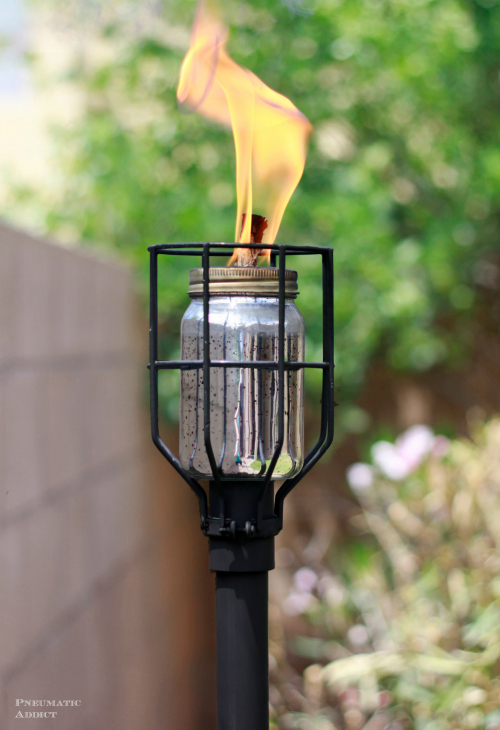 DIY industrial tiki torch of a metal bulb cage (via www.pneumaticaddict.com)