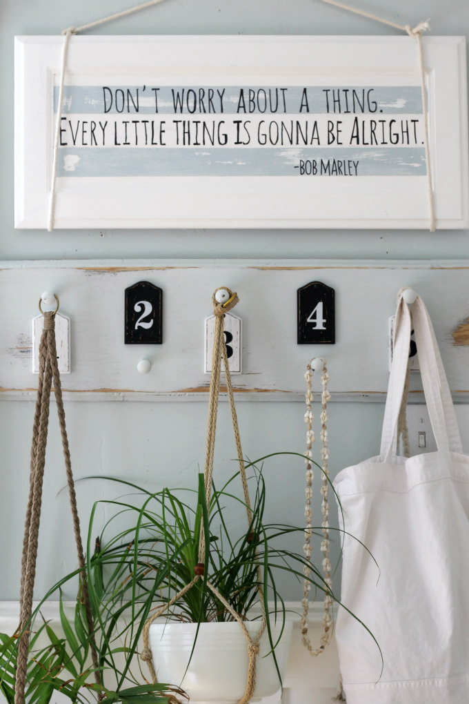 DIY striped calligraphy wooden sign of an old cabinet door (via cityfarmhouse.com)