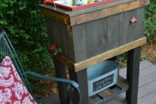 DIY wooden drink cooler with a chalkboard lid