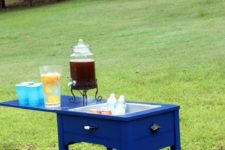 DIY vintage sewing table into a drink cooler station