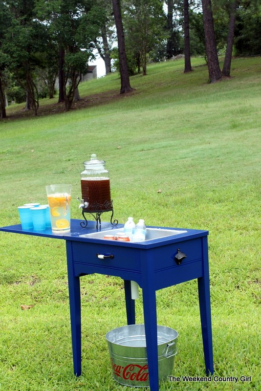 DIY vintage sewing table into a drink cooler station (via www.remodelaholic.com)