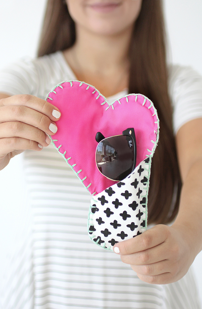 DIY black and white sunglasses case with a pink heart (via ispydiy.com)
