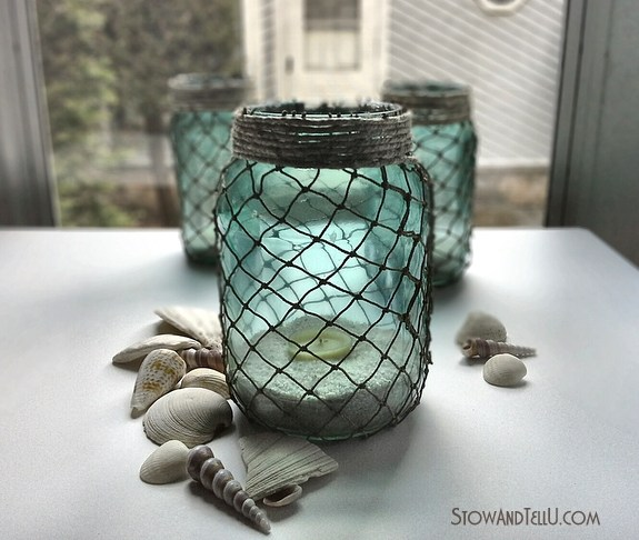 DIY turquoise luminaries with decorative netting (via stowandtellu.com)