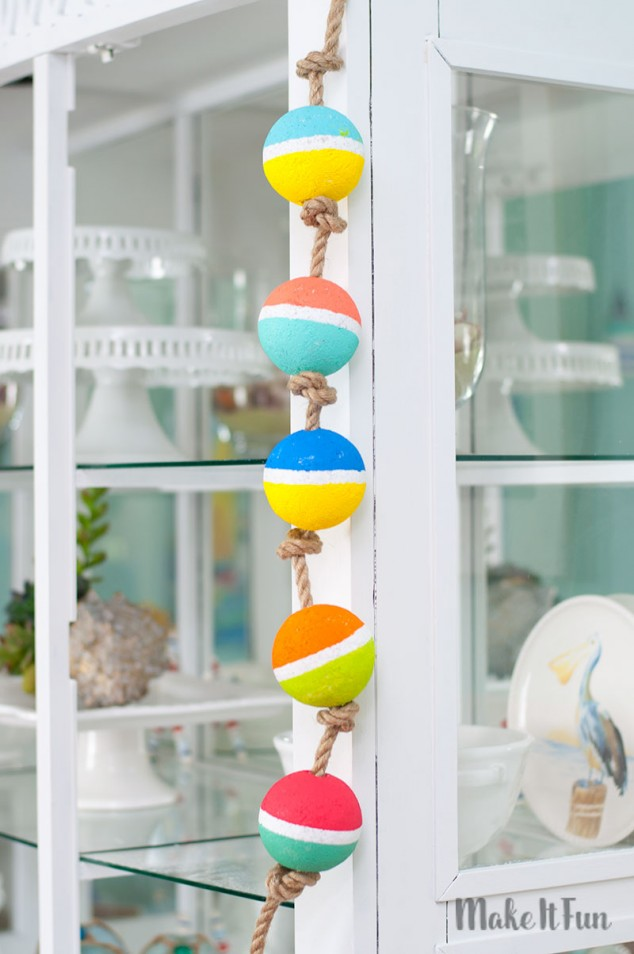 DIY colorful buoy garland of foam balls and rope