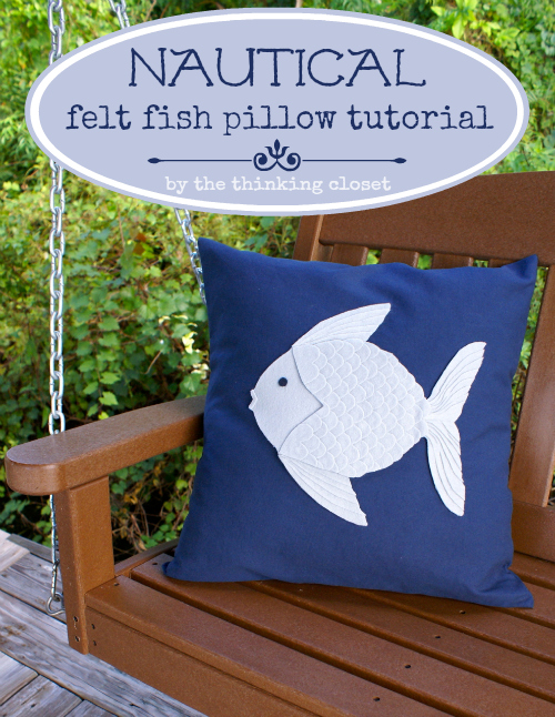DIY navy pillow with a white fish applique (via www.thinkingcloset.com)