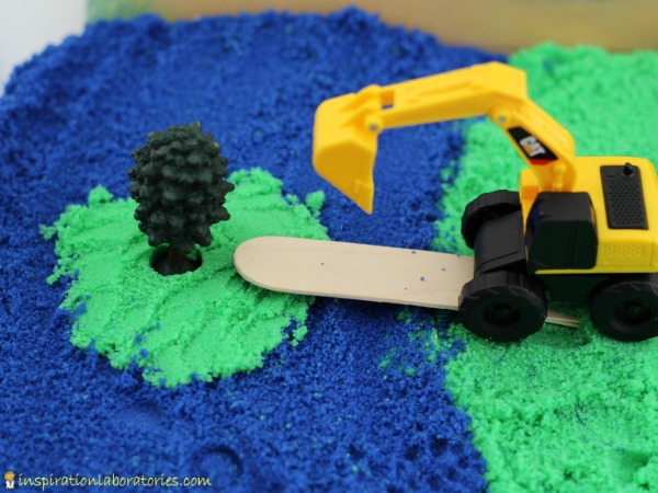DIY sensory construction bin with kinetic sand (via inspirationlaboratories.com)
