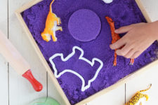 DIY purple kinetic sand of colored sand and cornstarch