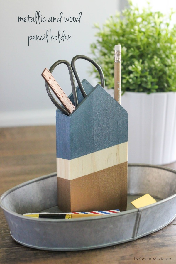 DIY painted house-shaped pencil holder (via www.purelykatie.com)