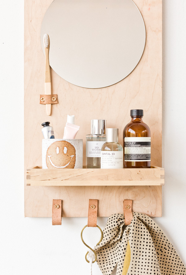DIY comfortable plywood bathroom organizer (via www.papernstitchblog.com)
