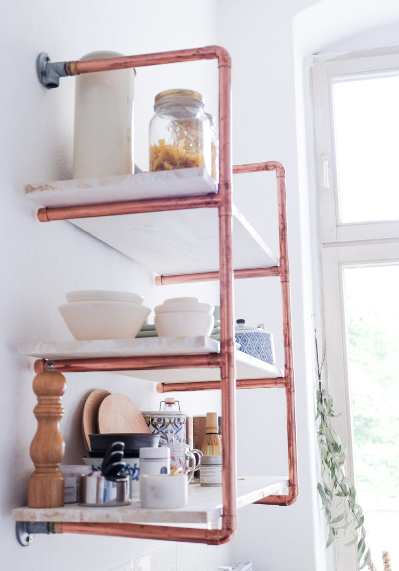 DIY copper piping and wood shelving unit (via heylilahey.com)