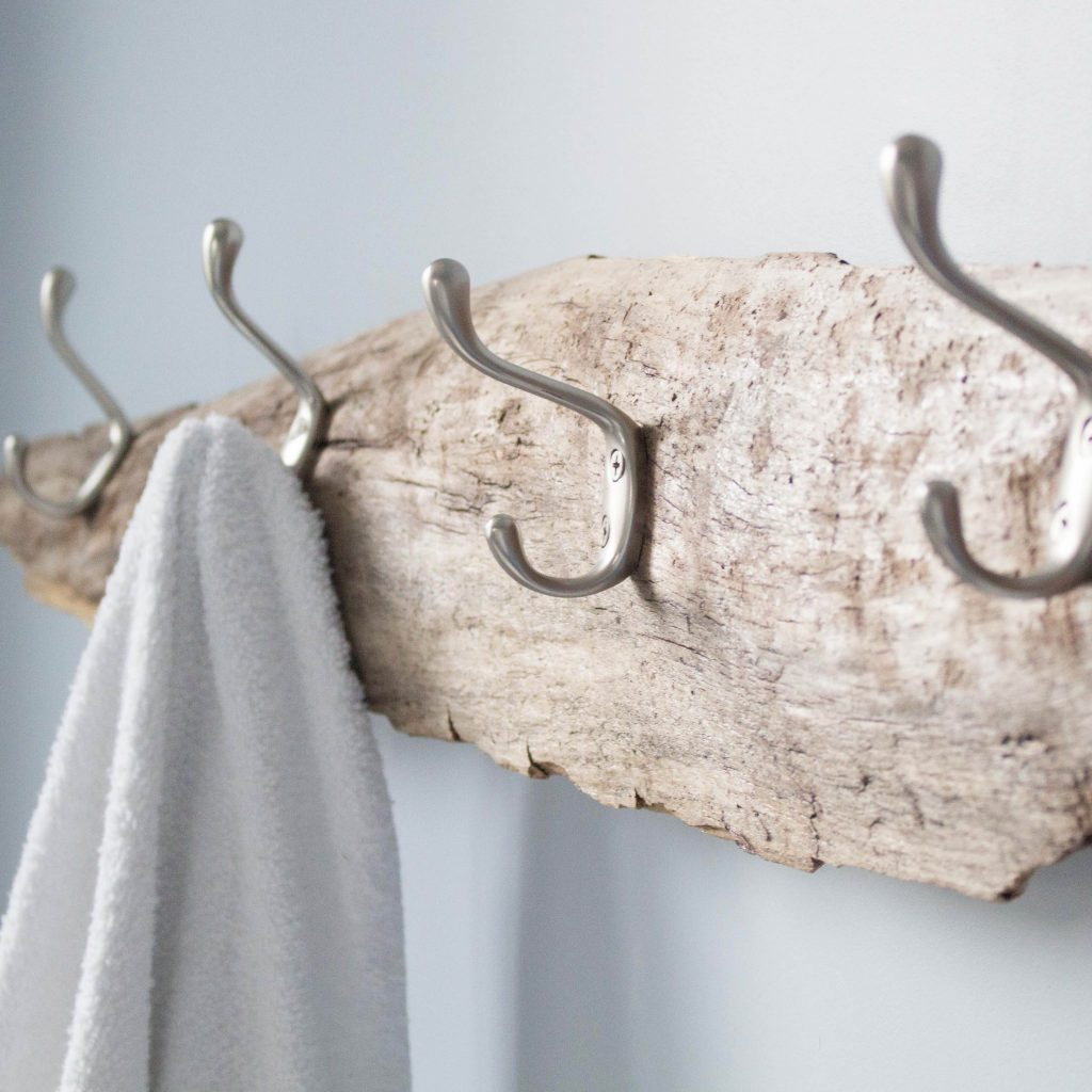 DIY driftwood towel rack for a coastal feel