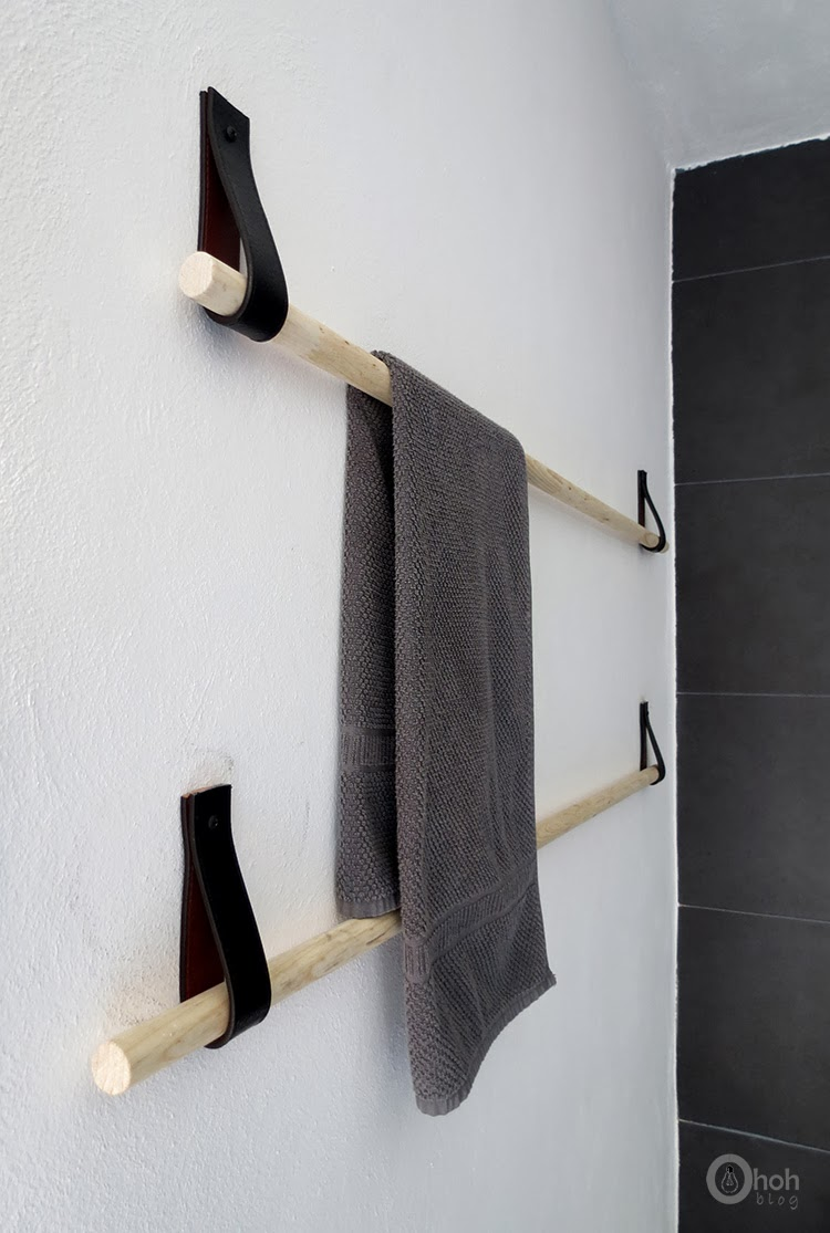 DIY minimalist towel rack of wood and black leather (via www.ohohdeco.com)