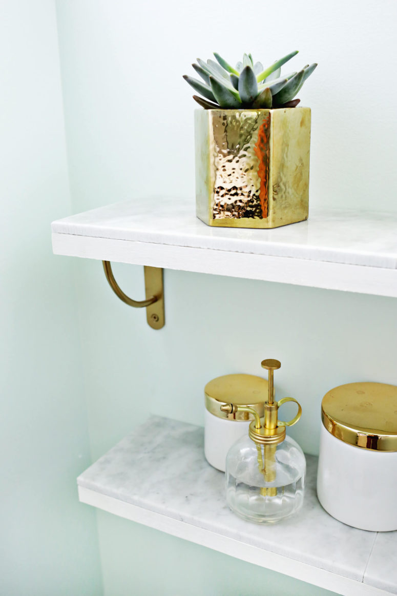 DIY marble and brass shelving piece (via abeautifulmess.com)