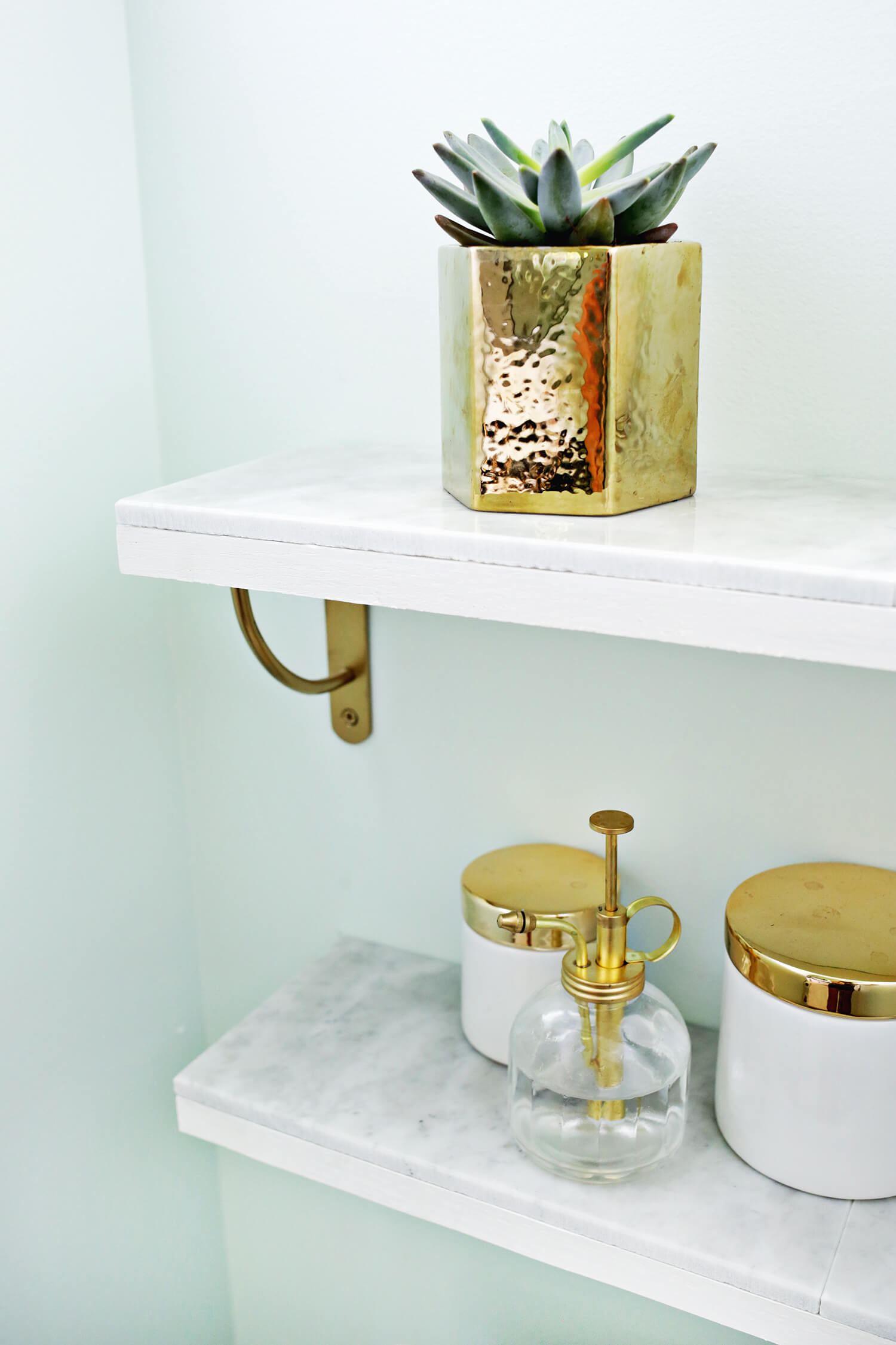 DIY marble and brass shelving piece
