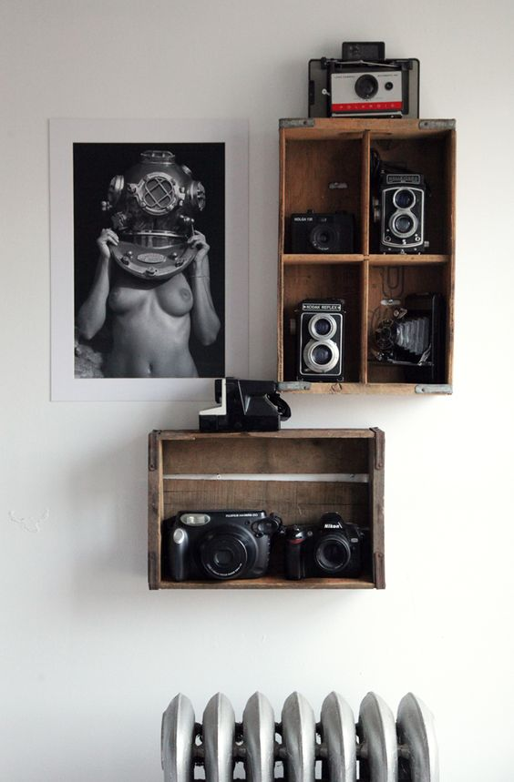 rustic box shelves to display cameras and a black and white photo to add style