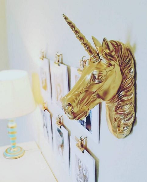 spruce up a faux horse head with a horn and gild up the whole piece and then attach to the wall as decor