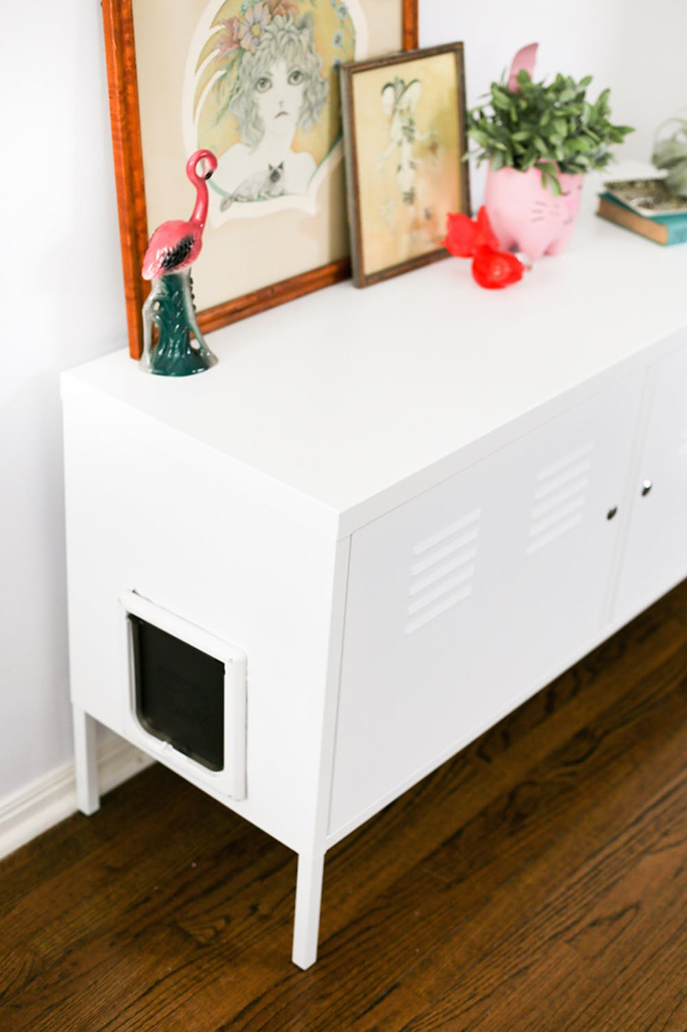 a cat litter box made of an IKEA metal cabinet is a smart and easy idea