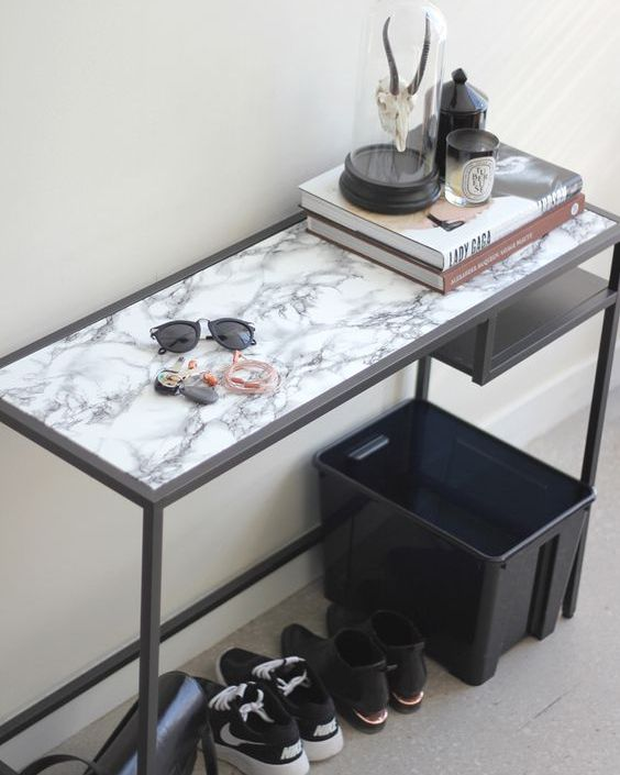 a modern entryway console table of an IKEA Vittsjo desk with a marble adhesive paper top