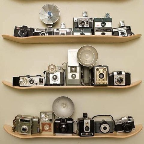remove wheels from your old skates and attach them to the wall to display the cameras