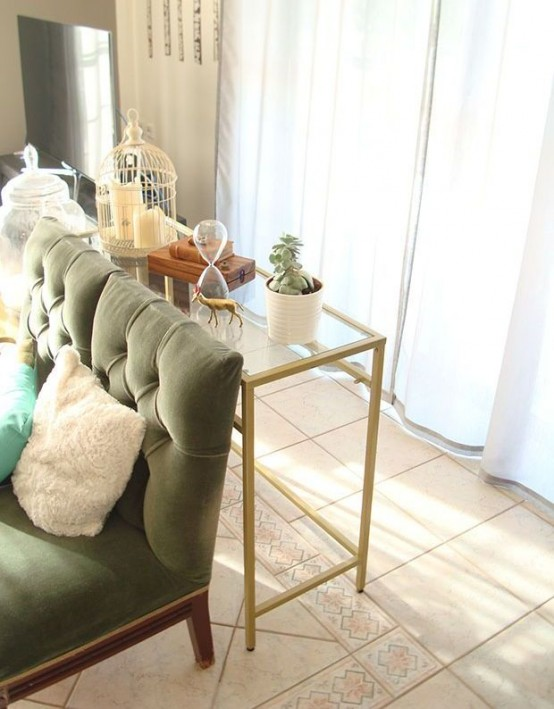 a gold Vittsjo desk used as a stylish modern console table in the living room