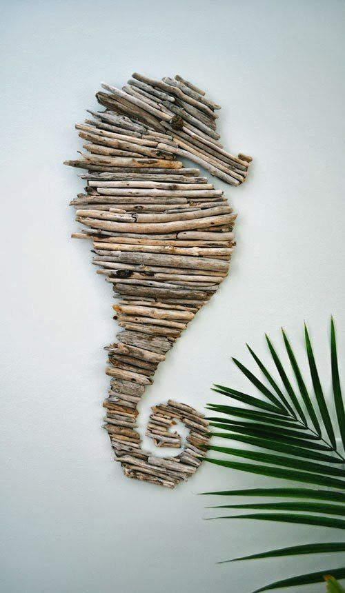 a sea horse artwork of driftwood is a great decor idea for any beach space