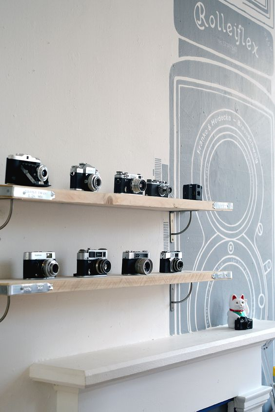 simple wooden shelves won't distract attention from your precious cameras