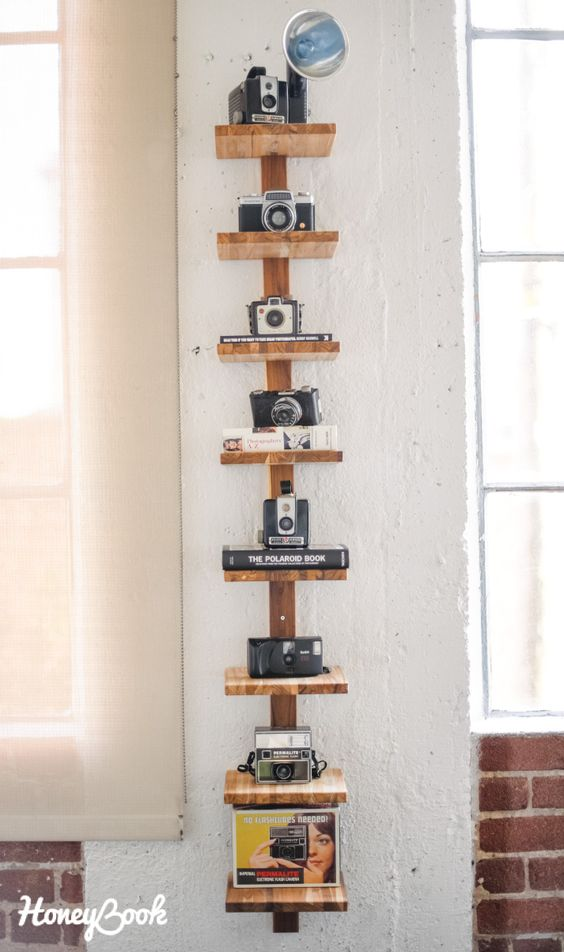 a vertical wooden shelf to display each camera individually and with style