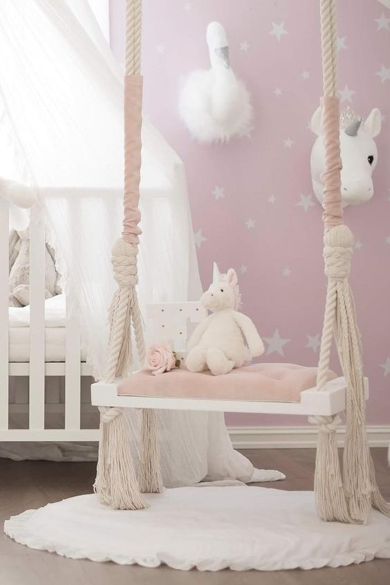 a faux unicorn and swan head on the wall will make your kids' nursery amazing
