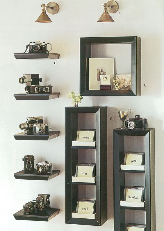 black floating shelves, individual for each camera and matching box shelves for other stuff