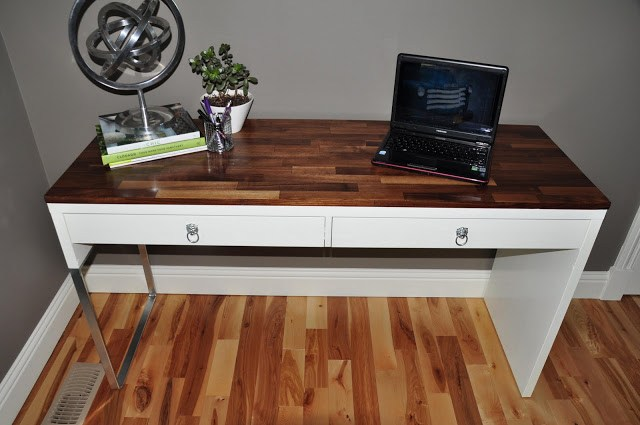 a Micke desk with chic silver handles and a wood clad tabletop