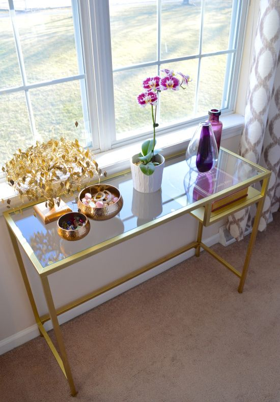 use a gold Vittsjo desk as part of your closet, store your makeup and jewelry here
