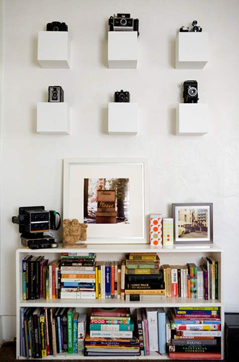 white cube shelves will add dimension and will display your cameras at their best