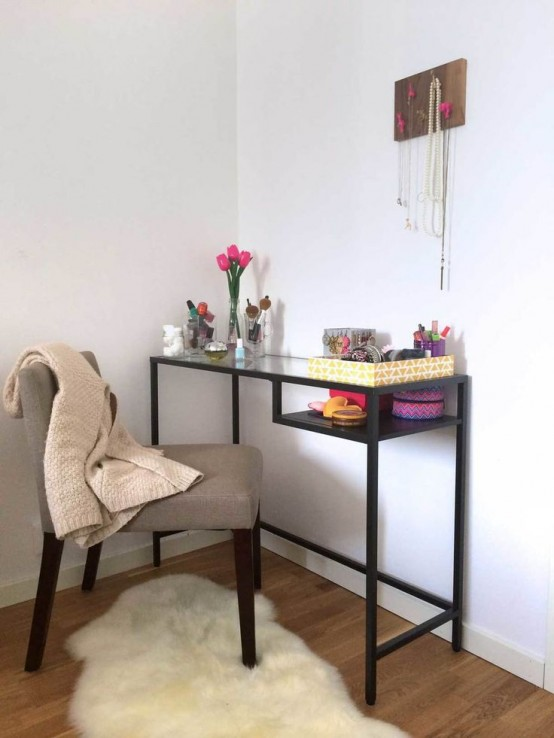 a Vittsjo desk turned into a comfy makeup table with enough storage on the top and behind it