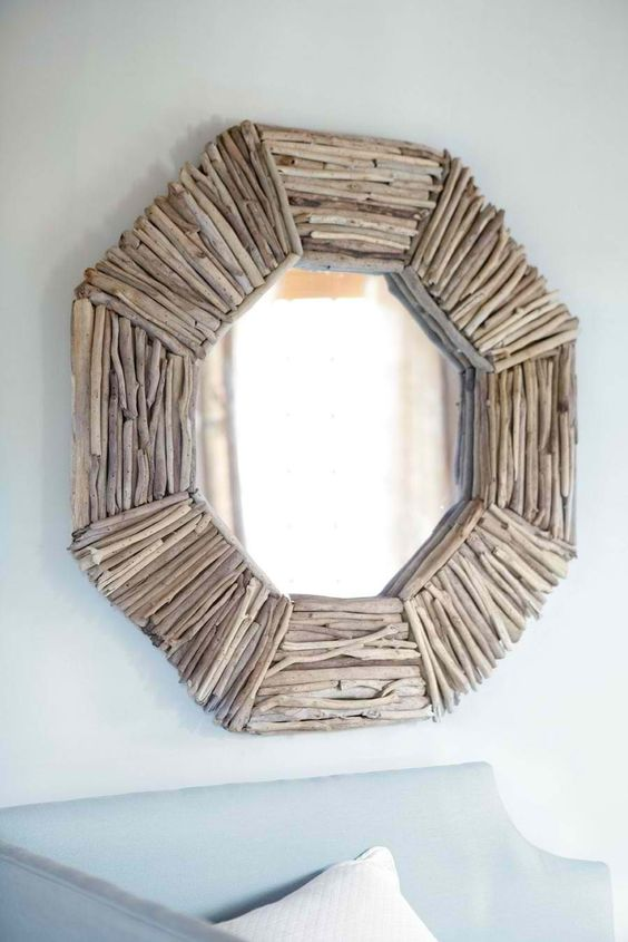 a chic hexagon-shaped driftwood mirror for a coastal entryway or bathroom
