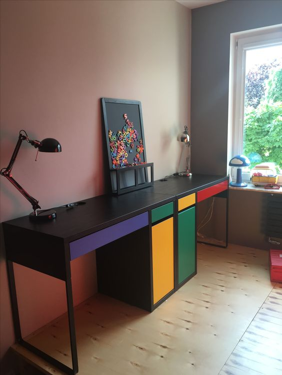 a colorful shared desk for a kids' room done in black and with touches of bold colors